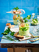 Asparagus with green sauce in a glass