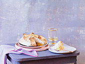 Lemon meringue pie, one slice on a plate