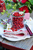 Wild strawberries in a glass
