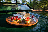 Homemade campfire bread with cherry tomatoes and avocado