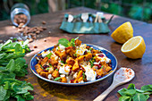 Roasted pumpkin salad with cranberries and almonds