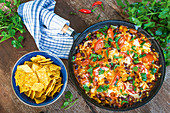 Pan-o-nachos with tomatoes and beans