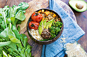 Rainbow lunch bowl with roasted pumpkin and black bean dip