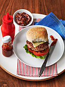 American cheese burger served with ketchup and relish