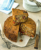 Apricot fruit cake cut with slce on top