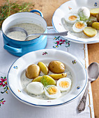Dill sauce with jacked potatoes and boiled eggs
