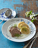 Dill sauce with boiled beef filet
