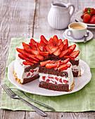 Cocoa tart (gateau) with strawberries