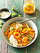 Small pancakes with caramelised apricots and lemon balm