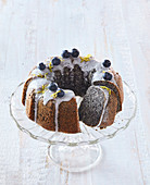 Poppy seed fancy bread with icing and blueberries