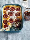 Rice pudding with plums and chocolate glaze