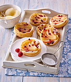 Puff pastry tartlets with marchpane and pears