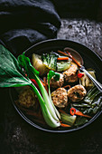 Asian meatballs in spicy bok choy and ginger soup