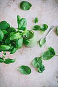 Green spinach, basil, yoghurt and banana smoothie