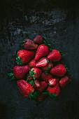 Strawberries on the dark surface