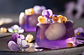 Lavender jelly with lychee, violets and white currants