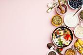 Oat granola with fresh berries, banana, yogurt, maple syrup and seeds