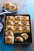 Poppy seed sweet buns with plums