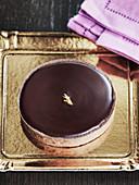 Chocolate tart on gold board