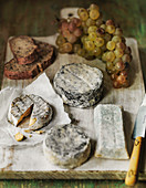selection of French Goats cheeses with bunch of grapes