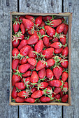 Top view of strawberries wood punnet outside