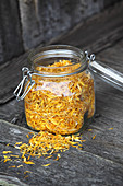 Dried arnica petals in a glass jar (naturopathy)