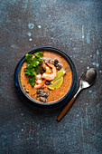 Spicy Thai soup Tom Yum with shrimp and seafood