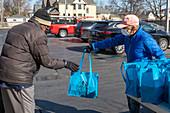 Volunteer distributing meals, Michigan, USA
