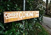 Covid 19 Go Home' sign