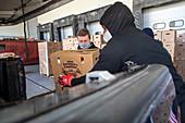 Volunteers distributing boxes of food