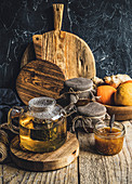 Hot tea and marmalade on a wooden background