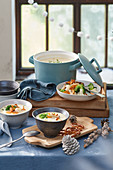 Cheese fondue soup with fried vegetables and chanterelles
