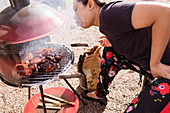 Woman having barbecue