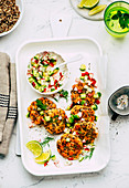 Quinoa and salmon trout patties with cucumber and radish salsa