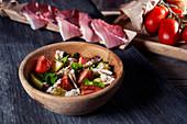 Potato and tomato salad with mackerel