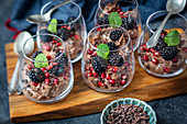 Chocolate mousse with mascarpone, blackberries, pomegranate and chocolate chips
