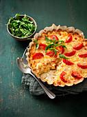 Italian style potato cake with tomatoes, cauliflower and salami