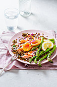Summer lentil and salmon salad with asparagus and soft boiled egg