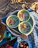 Cold fennel cream soup with peach and onion for a beach picnic