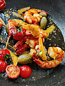 Fried scampi with baked tomatoes and caper apples