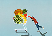 Girl pushing shopping cart full of fresh fruit