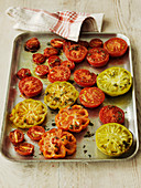 Selection of roast tomatoes on a baking tray