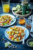 Cucumber and carrot salad with curried fried tofu