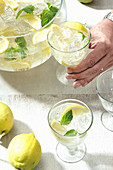 Sparkling wine bowl with gin, lemon and ice cubes