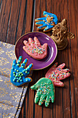 Cookies in the shape of the Indian protection symbol 'Hamsa's hand'