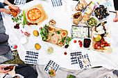 Food and drink on picnic blanket