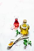 Ingredients for vinaigrette - olive oil, cherry vinegar