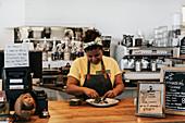 Woman in cafe preparing food