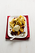 Oriental crêpes with ice cream, exotic fruit salad and honey