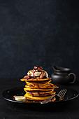 Pumpkin pancakes with banana and pecans